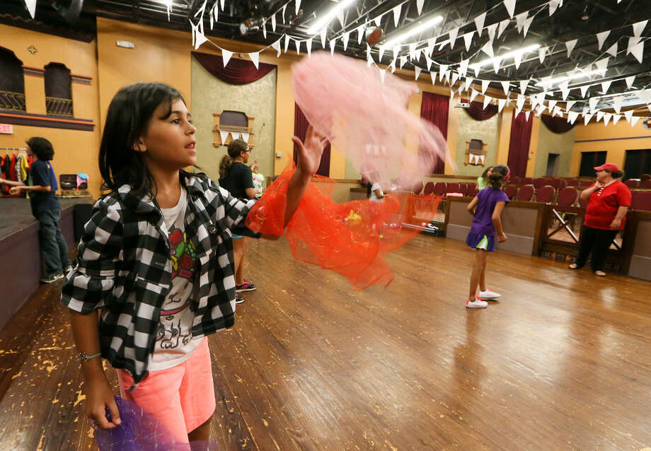 Nine-year-old Alani Nicole Arredondo concentrates as she  learns to juggle scarves during  the Summer Circus Camp at the Guadalupe Cultural Arts Center. Photo: Photos By Marvin Pfeiffer / Southside Reporter / EN Communities 2014