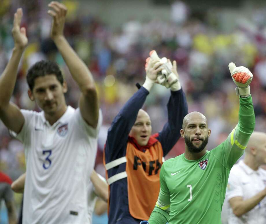 United States' goalkeeper Tim Howard (1) and his teammates celebrate after qualifying for the next World Cup round following their 1-0 loss to Germany. Photo: Associated Press / AP