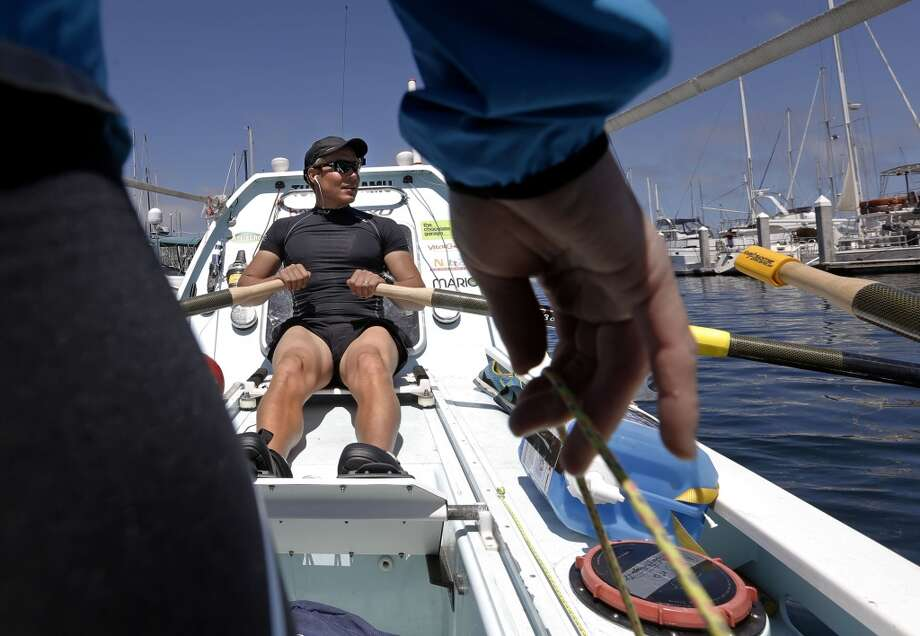 Sami Inkinen powers their vessel out of the marina as his wife Meredith Loring steers the rudder as they head out for a morning workout of rowing on Monterey Bay on Friday 13, 2014, in Monterey, Calif. Endurance athletes and techies, Inkinen and Loring like challenges and have decided to attempt to row from Monterey Bay all the way to Hawaii. Photo: Michael Macor, The Chronicle