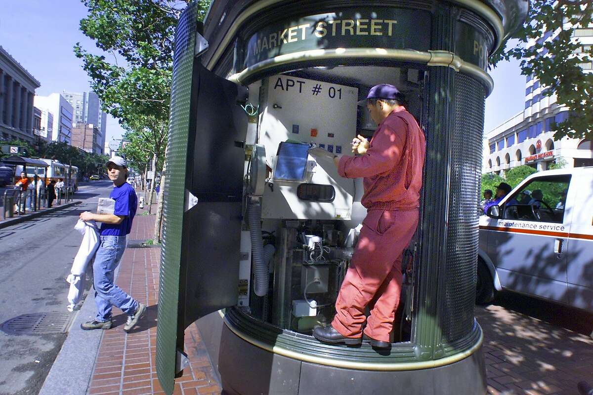 TOILETS3-C-03JUL01-MT-LH--JC DeCaux toilet located on Market at Powell streets being cleaned by maintenance worker. (BY LIZ HAFALIA/THE SAN FRANCISCO CHRONICLE)
