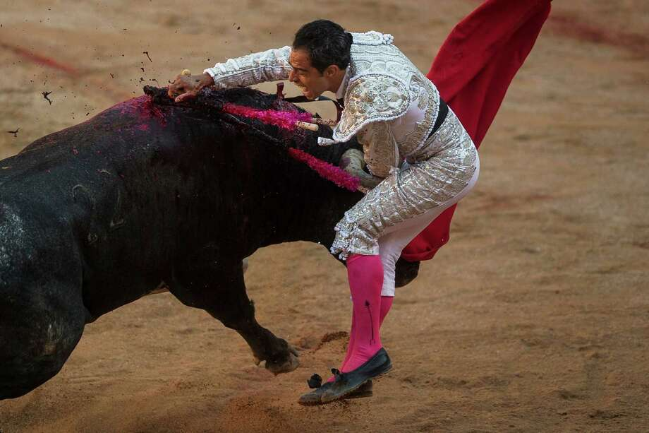 Colombian bullfighter Luis Bolivar kills a Miura ranch fighting bull during a bullfight of the San Fermin festival in Pamplona, Spain, Monday, July 14, 2014.  Photo: Andres Kudacki, Associated Press / AP