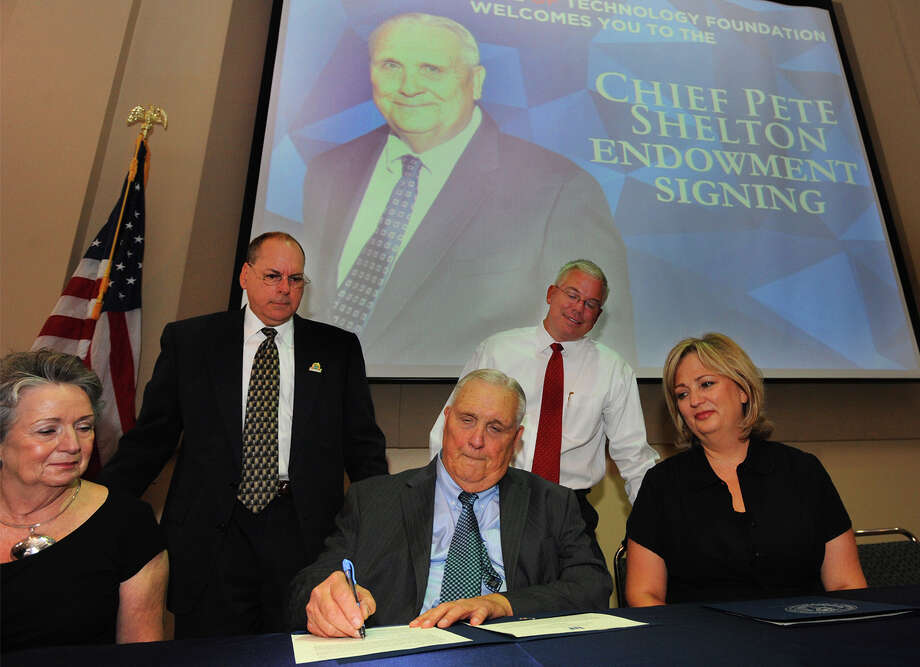 "C.A. ""Pete"" Shelton signs an endowment at Lamar Institute on Monday. The Endowment was created in Shelton's name to provide scholarships for fire, police and emergency medical students. Photo taken Monday, July 14, 2014 Guiseppe Barranco/@spotnewsshooter Photo: Guiseppe Barranco, Photo Editor"