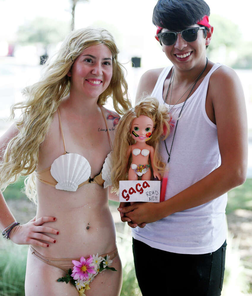 Lady Gaga fans Tiffany Alello (left) and Vincent Rodriguez wait for the concert Monday July 14, 2014 at the AT&T Center.