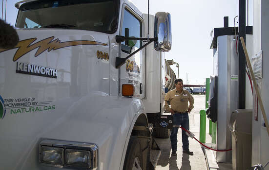 Juan Rodriguez, a truck driver for Dillon Transport, fills his truck with compressed natural gas at San Antonio's first public natural gas refueling station at Flying J's on Foster Road and I-10. Photo: Photos By Alma E. Hernandez / For The Express-News / San Antonio Express-News