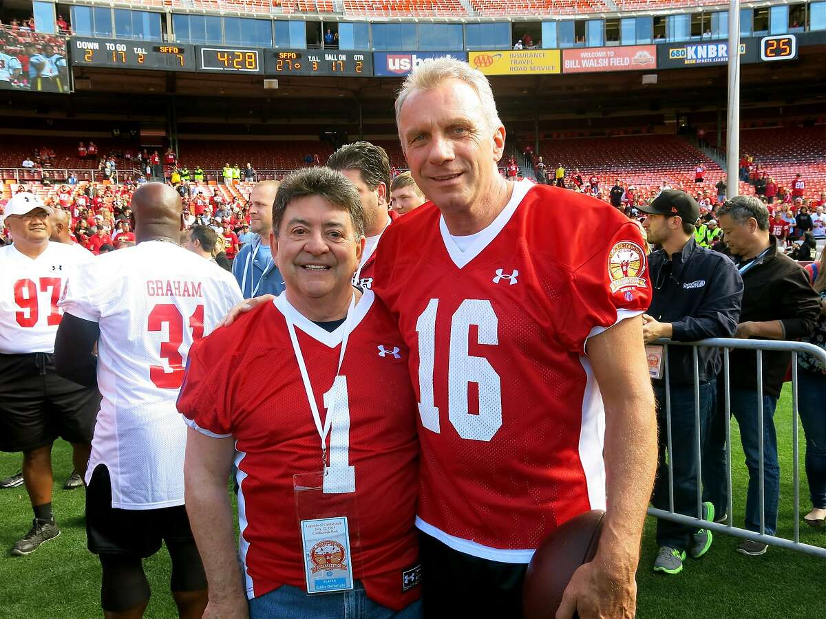 """Former 49ers owner Eddie DeBartolo (left) with former Niners quarterback Joe Montana during the """"Legends"""" game at Candlestick Park. July 2014. By Catherine Bigelow."""