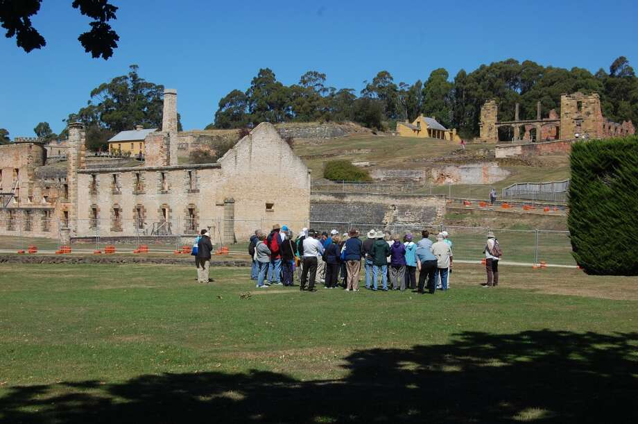 A tour group prepares to visit what remains of the high-security prison at Port Arthur on the Australian island of Tasmania. Photo: Bob McCullough, For The Express-News