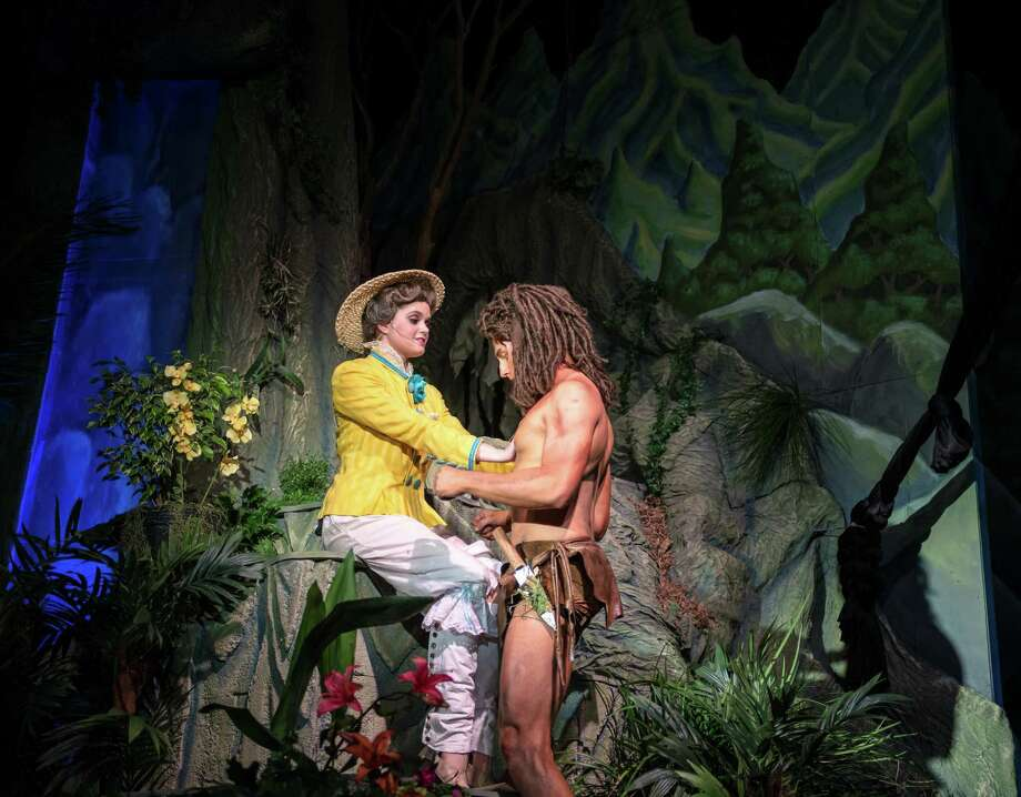 "Mia Migliaccio, left, and Mark Wilson play Jane and Tarzan in the Woodlawn Theatre's staging of ""Tarzan."" The play is nearing the end of its run; the last performance will be Sunday's matinee. Photo: Siggi Ragnar / Courtesy"
