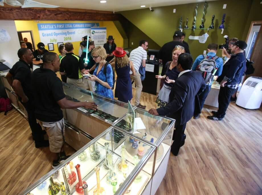 1. Starting with the most recent: Buy state-licensed, legal recreational marijuana (… when it shows back up) in the city. I-502 is having a rocky start with supply and only few stores opening, but it is a new industry with Big Brother breathing heavy down the state's neck so there's bound to be a few problems.Photo: Customers, reporters and photographers mingle inside Cannabis City in Seattle on Tuesday, July 8, 2014, the first day of legal recreational pot sales in the state. Photo: JOSHUA BESSEX/SEATTLEPI.COM