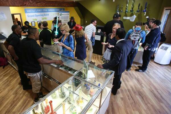 1. Starting with the most recent:  Buy state-licensed, legal recreational marijuana  (…  when it shows back up ) in the city. I-502 is having a rocky start with supply and only few stores opening, but it is a new industry with Big Brother breathing heavy down the state's neck so there's bound to be a few problems.      Photo: Customers, reporters and photographers mingle inside Cannabis City in Seattle on Tuesday, July 8, 2014, the first day of legal recreational pot sales in the state.