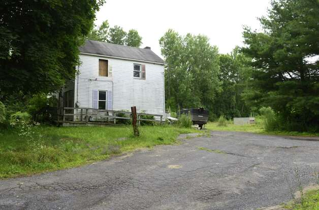 Derelict property at 4232 Albany Street Monday afternoon, July 14, 2014, in Colonie, N.Y. The owner is proposing to use this land to park more than 200 cars as a staging area for a dealership. (Will Waldron/Times Union) Photo: WW / 00027788A