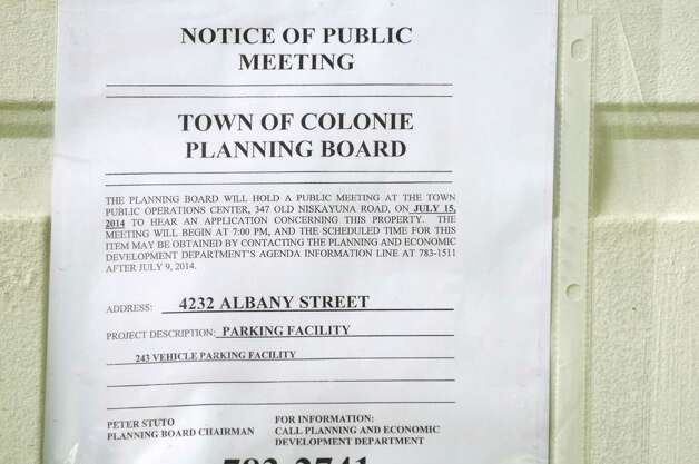 A notice of public meeting is placed on the front door of a derelict property at 4232 Albany Street Monday afternoon, July 14, 2014, in Colonie, N.Y. The owner is proposing to use this land to park more than 200 cars as a staging area for a dealership. (Will Waldron/Times Union) Photo: WW / 00027788A