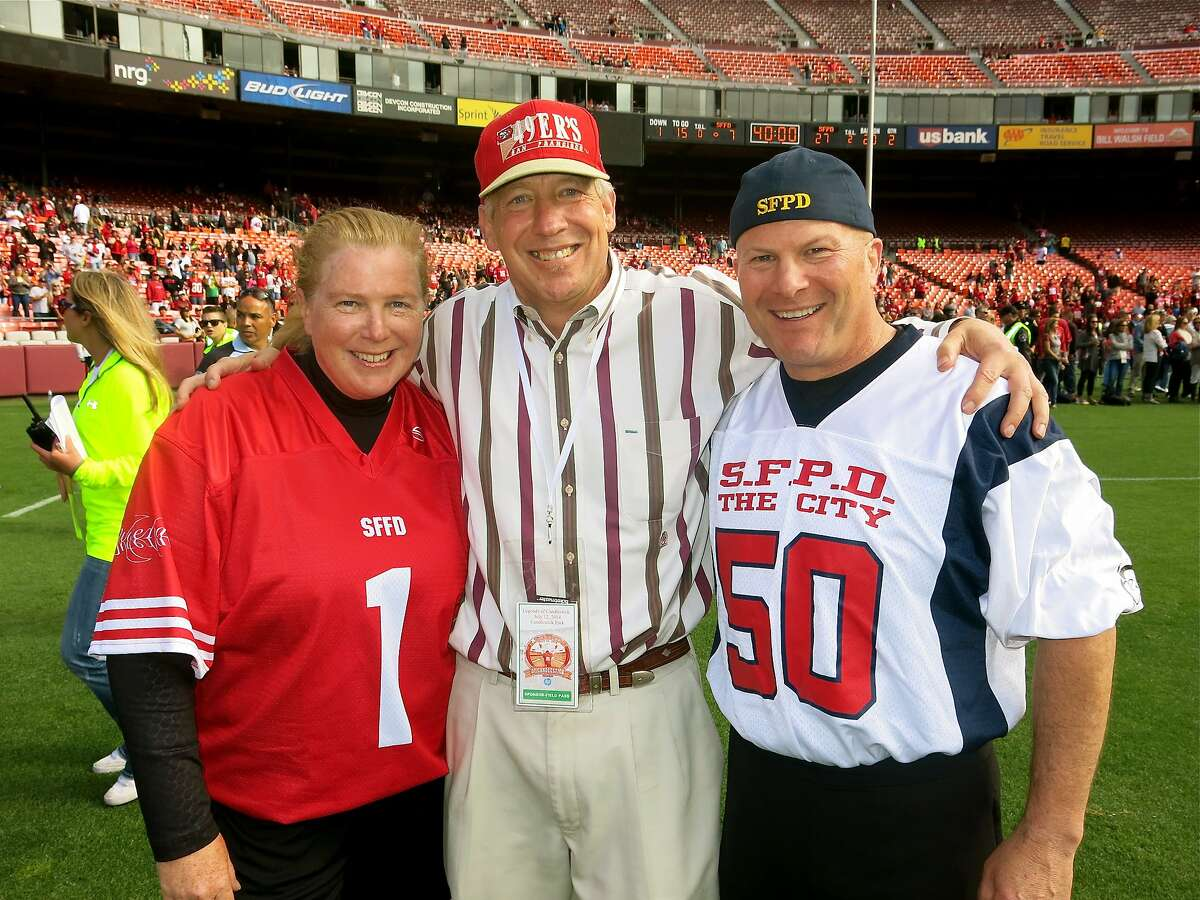 """SFFD Chief Joanne Hayes-White (left) with Epic Roasthouse Managing Partner Pete Sittnick and SFPD Chief Greg Suhr during the """"Legends"""" game at Candlestick Park. July 2014. By Catherine Bigelow. SFFD Chief Joanne Hayes-White (left) with Epic Roasthouse Managing Partner Pete Sittnick and SFPD Chief Greg Suhr during the """"Legends"""" game at Candlestick Park. July 2014. By Catherine Bigelow."""