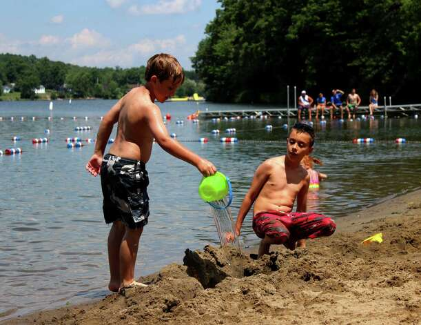 Nine-year-old Luke Cellucci of Brunswick, left, and Matthew Frost, 9, of Poestenkill, right, build sandcastles at the Dedrick Recreation Park beach Monday afternoon, July 14, 2014, in North Greenbush N.Y. (Selby Smith/Special to the Times Union) Photo: Selby Smith / 00027773B