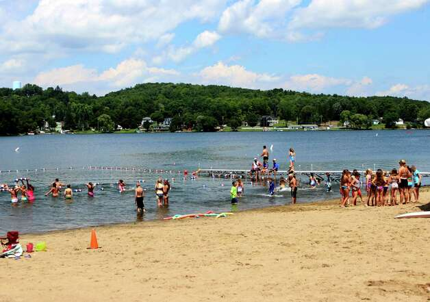 People enjoy the weather at Dedrick Recreation Park beach Monday afternoon, July 14, 2014, in North Greenbush N.Y. (Selby Smith/Special to the Times Union) Photo: Selby Smith / 00027773B