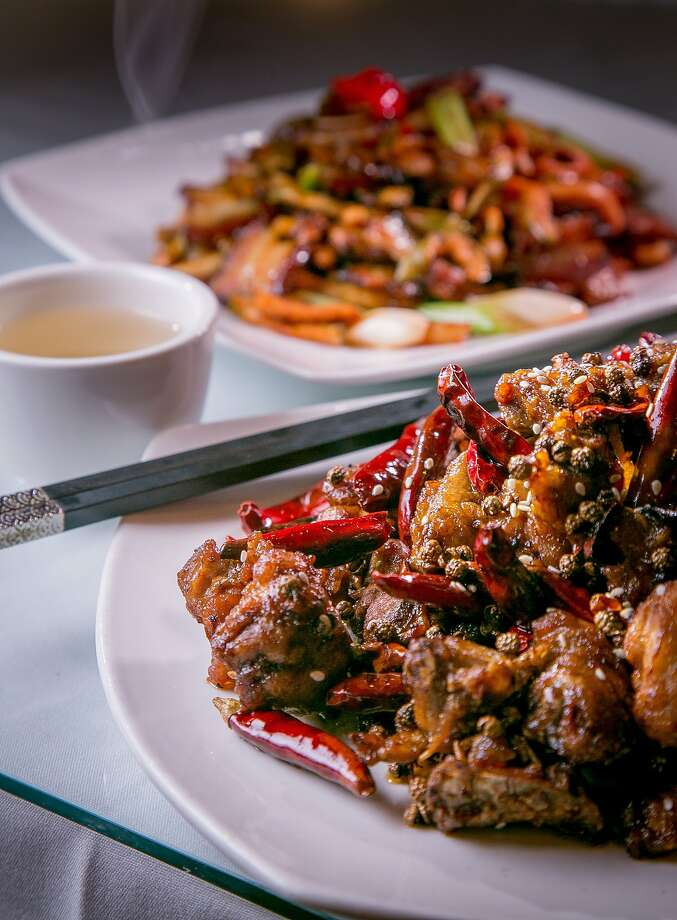The Hunan Spicy Chicken, (foreground), and the Fried Bacon Carrot at Made in China in San Francisco, Calif. are seen on Thursday, July 3rd, 2014. Photo: John Storey, Special To The Chronicle