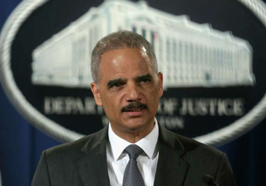 WASHINGTON, DC - JULY 14:  U.S. Attorney General Eric Holder speaks during a news conference for a major financial fraud announcement at the Justice Department July 14, 2014 in Washington, DC. Citigroup has agreed to pay the government $7 billion in fines for its misleading investors about some of the mortgage-backed securities sold prior to January 1, 2009.  (Photo by Alex Wong/Getty Images) ORG XMIT: 501839769 Photo: Alex Wong / 2014 Getty Images