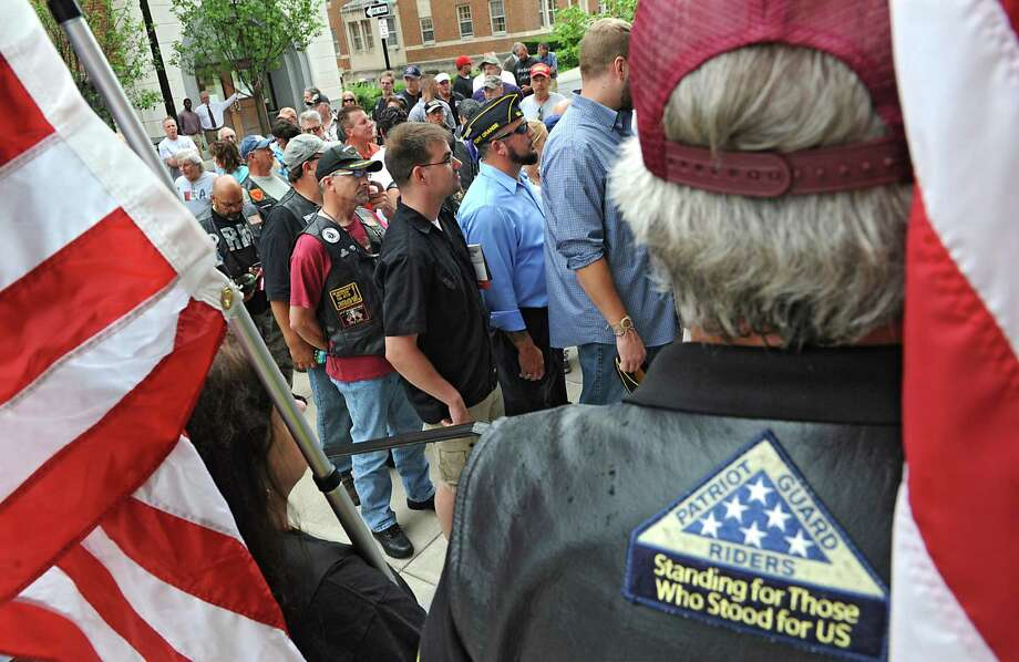 Dozens of veterans rallied outside the Albany County Courthouse for veteran housing and then entered the courthouse to attend an Albany County LegislatureOs meeting on Monday, July 14, 2014 in Albany, N.Y. County Executive Daniel McCoy says lawmakers are stalling the Soldier On initiative to create veterans housing at the old Ann Lee Home. (Lori Van Buren / Times Union) Photo: Lori Van Buren / 00027781A