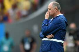 (FILE) Brazil's coach Luiz Felipe Scolari reacts during the third place play-off football match between Brazil and Netherlands during the 2014 FIFA World Cup at the National Stadium in Brasilia on July 12, 2014. Brazil's football confederation (CBF) confirmed on July 14, 2014 that it will not renew Scolari's contact, as local media reported early Monday, just hours after Germany defeated Argentina to win the 2014 World Cup. Scolari has said that he would let the CBF decide his fate after his team lost the game for third place 3-0 to the Netherlands on Saturday, and after being crushed by Germany in a humiliating 7-1 defeat earlier in the week. AFP PHOTO / VANDERLEI ALMEIDAVANDERLEI ALMEIDA/AFP/Getty Images