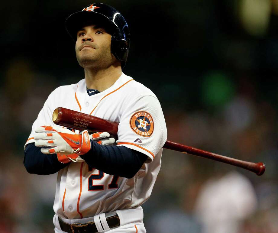 Houston Astros second baseman Jose Altuve (27) reacts to hitting a foul ball during the first inning of an MLB baseball game at Minute Maid Park, Tuesday, June 24, 2014, in Houston.  ( Karen Warren / Houston Chronicle  ) Photo: Karen Warren, Staff / © 2014 Houston Chronicle