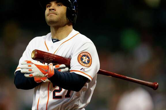 Houston Astros second baseman Jose Altuve (27) reacts to hitting a foul ball during the first inning of an MLB baseball game at Minute Maid Park, Tuesday, June 24, 2014, in Houston.  ( Karen Warren / Houston Chronicle  )