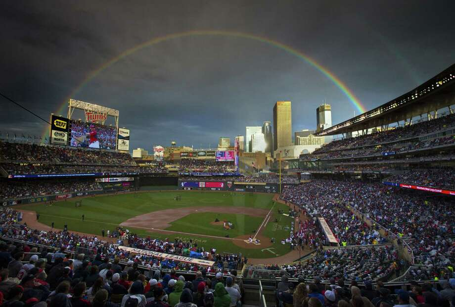 A rainbow signals the end of a 54-minute weather delay that postponed the start of Monday night's Home Run Derby at Target Field in Minneapolis. Photo: Brian Mark Peterson, MBO / The Star Tribune
