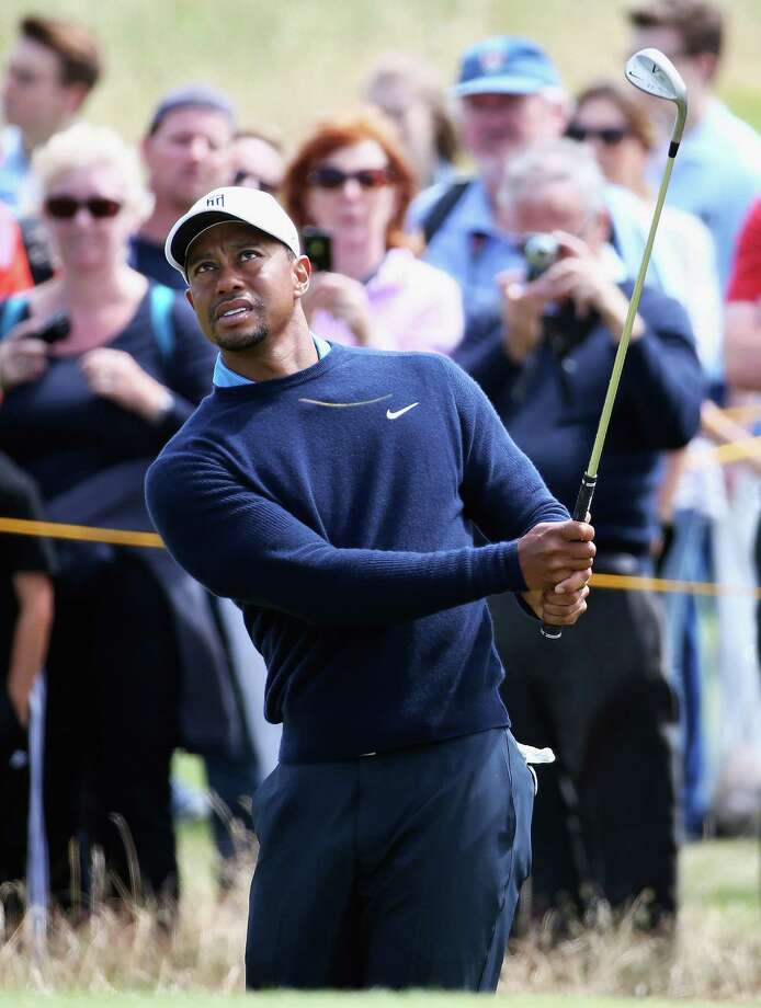 HOYLAKE, ENGLAND - JULY 13:  Tiger Woods of the USA chips onto the 6th green during a practice round ahead of the 143rd Open Championship at Royal Liverpool on July 13, 2014 in Hoylake, England.  (Photo by Matthew Lewis/Getty Images) ORG XMIT: 501659201 Photo: Matthew Lewis / 2014 Getty Images