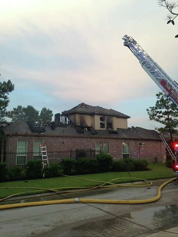 A lightning strike led to a house fire on Sagamore Ridge Place in the Woodlands on Monday. (Photo by Scott Engle/Montgomery County Police Reporter)