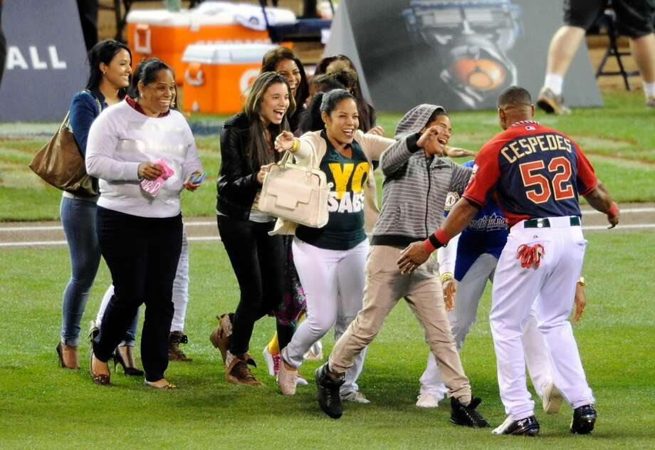 MINNEAPOLIS, MN - JULY 14:  American League All-Star Yoenis Cespedes #52 of the Oakland A's celebrates with his family after winning the Gillette Home Run Derby at Target Field on July 14, 2014 in Minneapolis, Minnesota.  (Photo by Hannah Foslien/Getty Images) Photo: Hannah Foslien, Getty Images