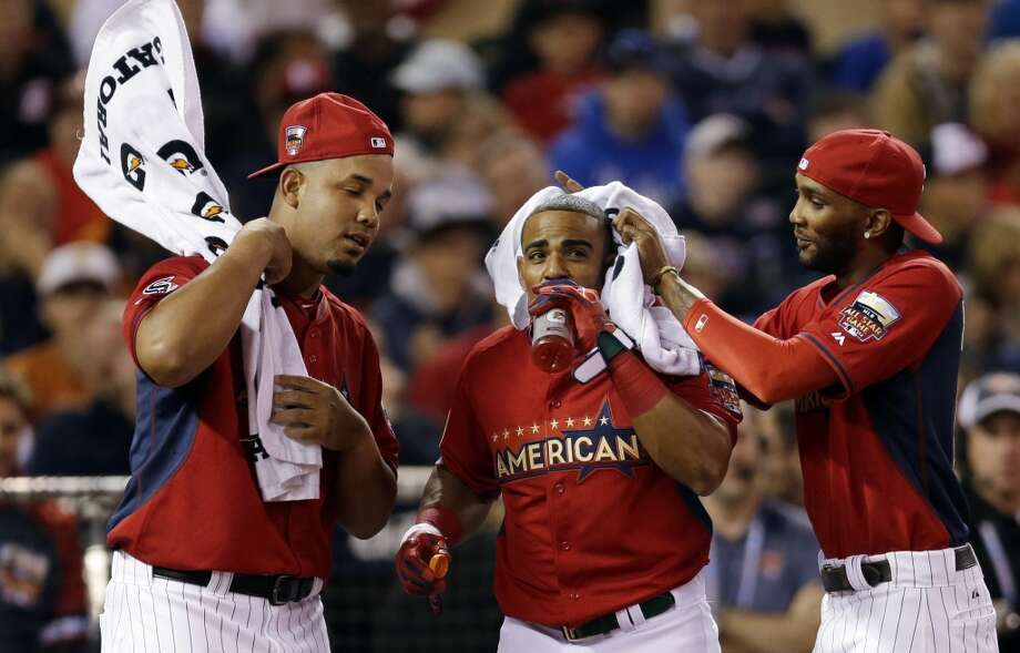 Teammates cool off American League's Yoenis Cespedes in between pitches during the MLB All-Star Home Run Derby. Photo: Jeff Roberson, Associated Press