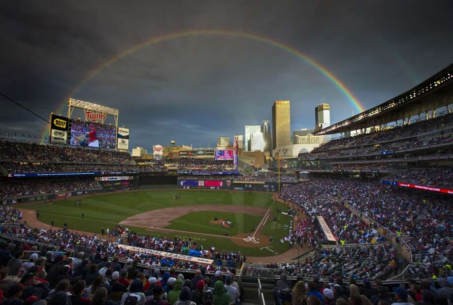 A rainbow stretches across the Minneapolis sky after a rain delay. Photo: Brian Mark Peterson, Associated Press