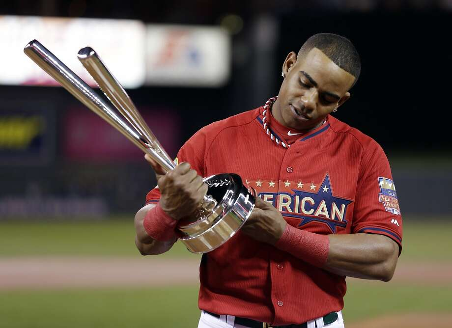 American League's Yoenis Cespedes, of the Oakland Athletics, holds the trophy after winning the Home Run Derby on July 14. Photo: Jeff Roberson, Associated Press