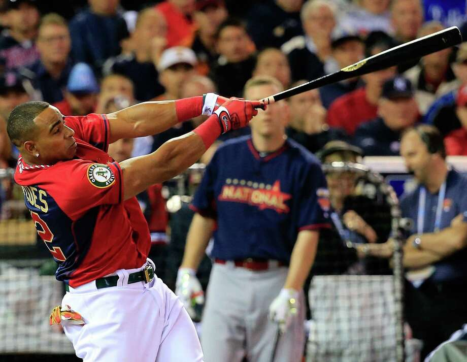 Oakland's Yoenis Cespedes outslugged Cincinnati's Todd Frazier 9-1 in the final round of the home run derby. Last season, he edged Washington's Bryce Harper 9-8 in the final. Photo: Rob Carr / Getty Images / 2014 Getty Images