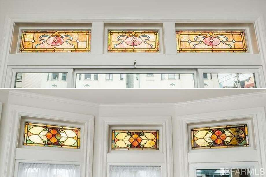 The stained glass windows were kept; the wood trim was painted white. Photo: MLS