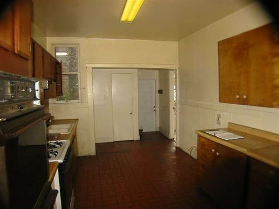 The original kitchen was closed off from the dining areas, not to mention very out of date. Photo: MLS