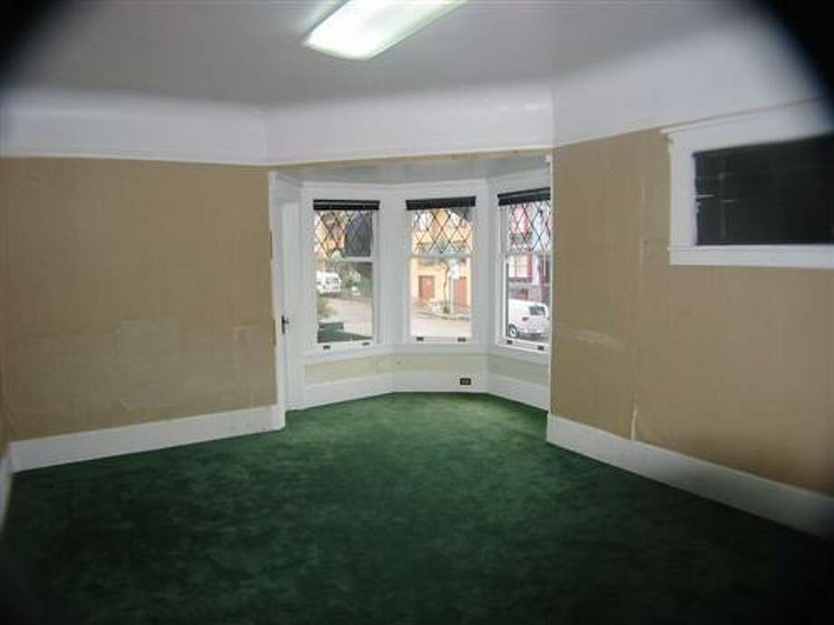 Many rooms had dark, unmatched carpeting before the remodel. Photo: MLS