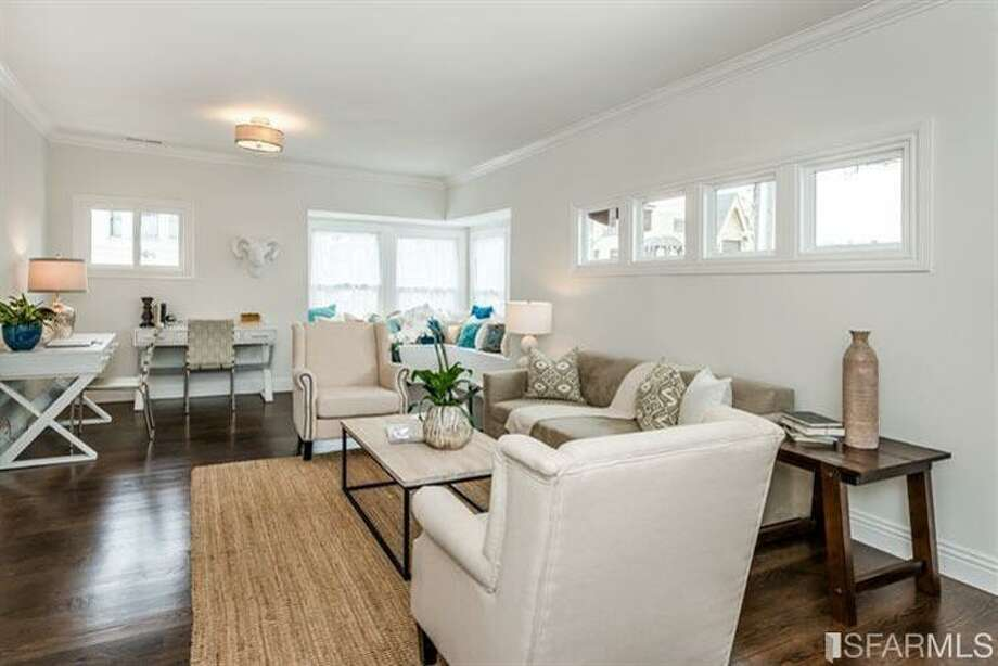 Now hardwood floors run throughout the main living spaces. Photo: MLS