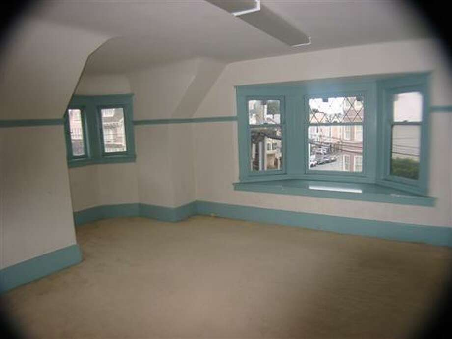 Here's a top-floor bedroom before the remodel. Photo: MLS