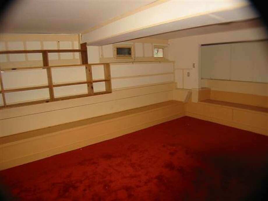 The downstairs space before. Photo: MLS