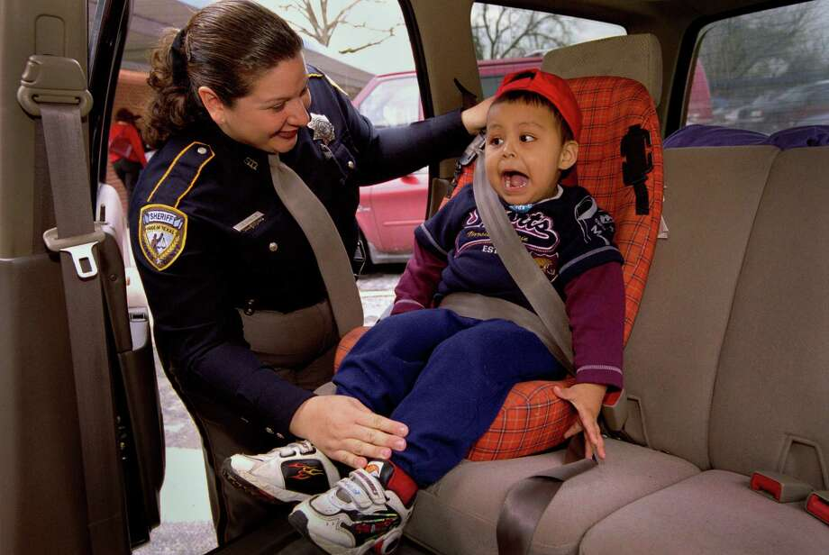 Child car seats and boostersState law requires themfor children under 8 years old and shorter than 4-foot-9. Rear-facing seats are required for infants up to 35 pounds. Boosters are OK for kids 4-8 years old and over 40 pounds. Photo: Joshua Trujillo, . / Houston Chronicle