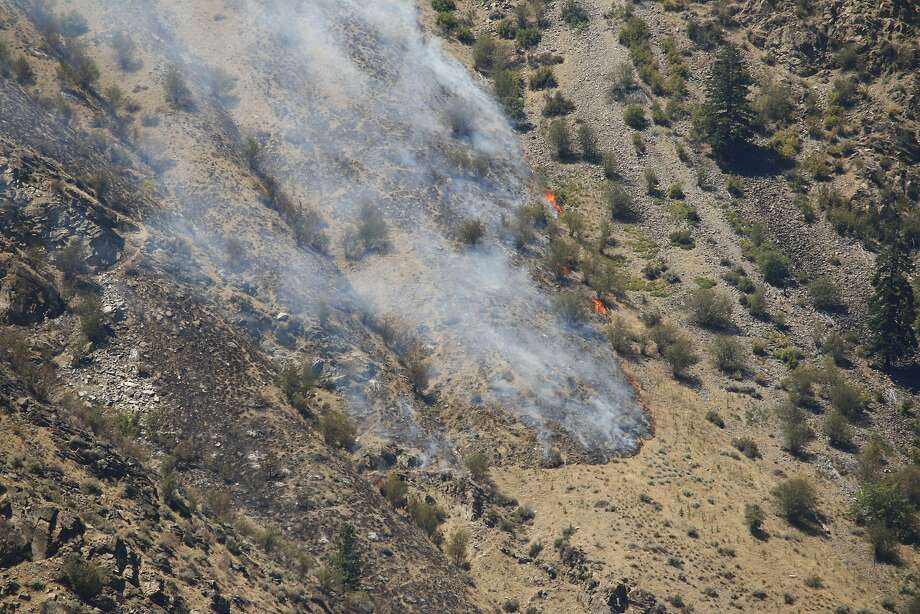 A wildfire burns near Entiat, Wash., Friday, July 11, 2014. Several hundred firefighters worked Friday to contain the fire that has burned grass and brush across nearly 30 square miles in central Washington. Photo: Rachel La Corte, Associated Press