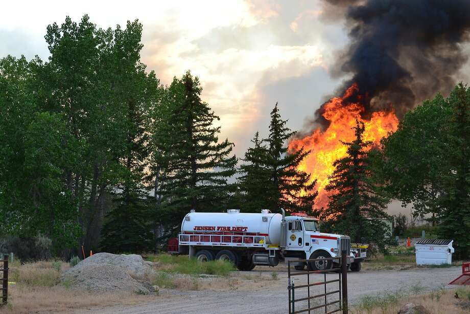 This Saturday, July 5, 2014, photo provided by the Utah State Parks shows the fire from the Taylor Mountain Road Fire near Vernal, Utah. Authorities say a 5-square-mile wildfire north of Vernal has burned three structures but is now 25 percent contained. Utah fire officials say they plan to continue putting a perimeter around the Taylor Mountain Road Fire on Monday. Rangers say Steinaker State Park remains closed as crews use it as a staging area.  Photo: Associated Press