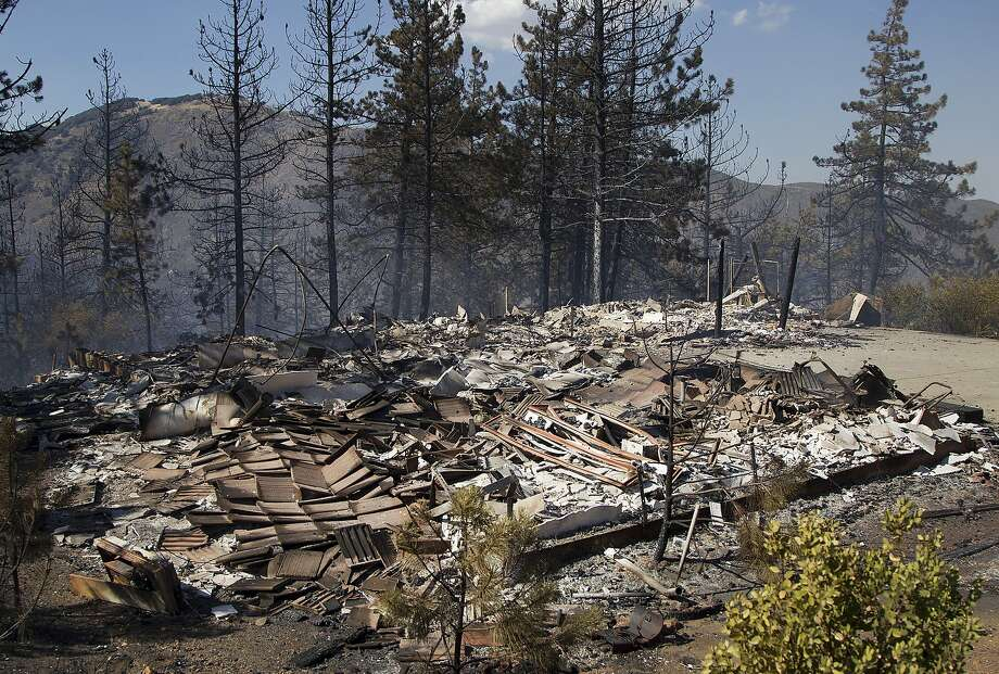 The foundation is all that is left of a house following a wildfire Thursday, July 3, 2014, in the Julian, Calif., area.  Photo: Sean M. Haffey, Associated Press