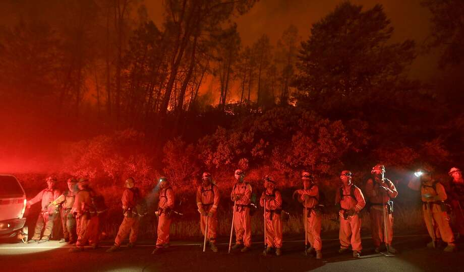 A Delta inmate crew with Cal Fire prepares to cut a line around the Butts Fire along Butts Canyon Road, Tuesday July 1, 2014, near Middletown Calif. By early evening, The fire in remote Pope Valley grew to 3,800 acres from 3,200 acres on Wednesday, said Daniel Berlant, a spokesman for the California Department of Forestry and Fire Protection. The blaze is not threatening any major vineyards, Berlant and a spokeswoman for a vintners association said. Photo: Kent Porter, Associated Press