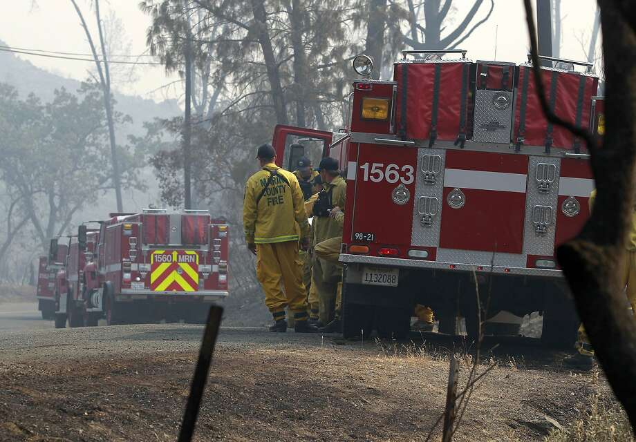 Fire crews from Marin County are shown on Snell Valley Road near Berryessa Estates, Calif., on Wednesday, July 2, 2014. A raging wildfire in rural Northern California has spread over 5 square miles and forced the evacuation of 200 homes in Napa County, but was not threatening any major vineyards on Wednesday, a fire official and a spokeswoman for a vintners association said. Photo: Paul Chinn, Associated Press