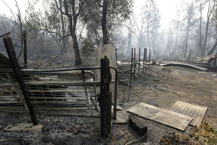 A destroyed shed is seen off Butts Canyon Road near Middletown, Calif., on Wednesday, July 2, 2014. A raging wildfire in rural Northern California has spread over 5 square miles and forced the evacuation of 200 homes in Napa County.  Photo: Paul Chinn, Associated Press