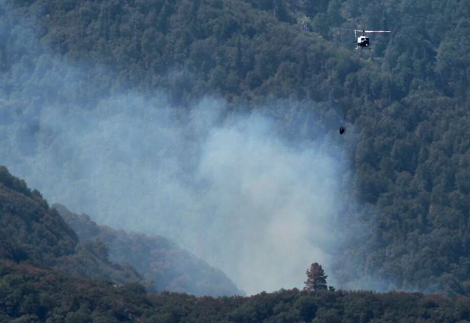 A helicopter makes a water drop on the Ranch Fire, Wednesday, July 2, 2014 and has consumed 100 acres, west of Rancheria Road in the Greenhorn Mountains. Ground crews have not gained access yet, but a strong air suppression is underway including several air tankers and helicopters.  Photo: Casey Christie, Associated Press