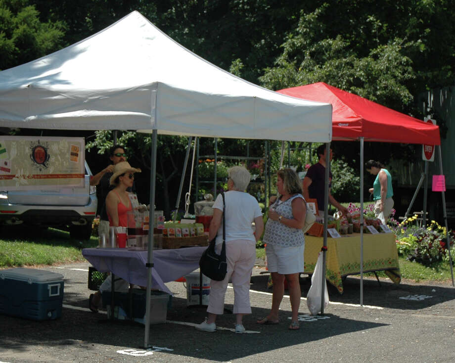 The New Canaan Farmers' Market, at the old Center School parking lot at South Avenue and Maple Street, is open from 10 a.m. to 2 p.m. Saturday through Nov. 22. File photo Photo: Contributed Photo / New Canaan News