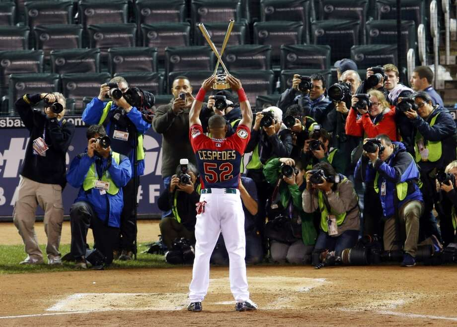 American League's Yoenis Cespedes, of the Oakland Athletics,  celebrates with the trophy after winning the MLB All-Star Home Run Derby. Photo: Paul Sancya, Associated Press
