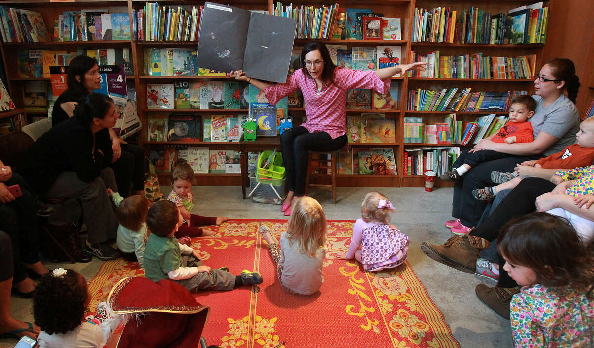 Anastasia McKenna tells a story last November in front of kids and parents gathered at the Twig book shop. McKenna is known to most as Miss Anastasia.