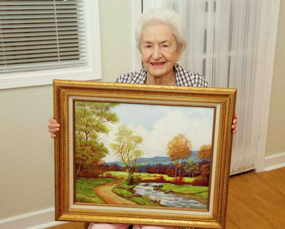 Treemont resident and artist Murrell Hill shows off a recent painting.